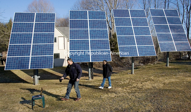 OXFORD, CT. 10 February 2012-020812SV03-From left, Bruce Angeloszek, owner of CT Solar Services, shows Ramiro Barriga of Oxford some of the features of his new solar system the company installed at his home in Oxford Friday..Steven Valenti Republican-American