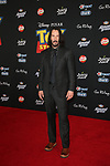 """LOS ANGELES, CALIFORNIA - JUNE 11: Keanu Reeves attends the premiere of Disney and Pixar's """"Toy Story 4"""" on June 11, 2019 in Los Angeles, California.  Credit: Faye Sadou / MediaPunch"""