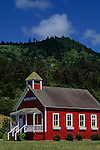 Little Red School House under blue skies Stone Lagoon Northern California USA.