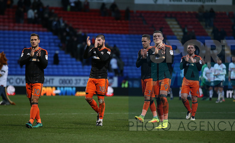 Sheffield Utd players walk off dejected during the FA Cup Second round match at the Macron Stadium, Bolton. Picture date: December 4th, 2016. Pic Simon Bellis/Sportimage