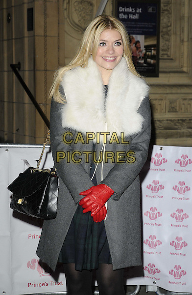 Holly Willoughby.The 'We Are Most Amused' Prince's Trust Comedy Gala, Royal Albert Hall, Kensington Gore, London, England..November 28th, 2012.half length fur coat grey gray white collar wrap red gloves black tights bag purse .CAP/CAN.©Can Nguyen/Capital Pictures.