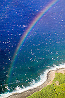 MOLOKAI, HI - A view of a double rainbow over the Pacific Ocean and island coastline from the top of the worlds highest sea cliffs on Molokai, Hawaii.  The cliffs drop about 1010 meters into the Pacific Ocean at their highest point.