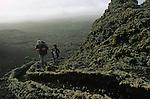 Montee par une ancienne coulee de lave dans le parc de Timanfaya. Ile de Lanzarote.