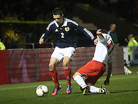Ryan Jack tackled by Alessandro Alunni in the Scotland v Luxembourg UEFA Under 21 international qualifying match at St Mirren Park, Paisley on 6.9.12.