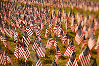 "Exactly 2,997 flags (one for each victim of 9/11) were placed in the shape of the Twin Towers near downtown Charlotte in September 2009 in memory of those who lost their lives on Sept. 11, 2001. The flags for ""Flags of Remembrance,"" placed on Sept. 9, 2009, were coordinated by the Firefighter Steven Coakley Foundation. Coakley was a firefighter on FDNY Engine 217 who died on 9/11. The flags were placed at the Palmer Building, 2601 E. 7th St., Charlotte, NC."