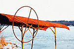 An old boat lift stands at the edge of the partially frozen Mississippi River near Le Claire Iowa.