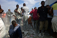 Port Au Prince, Haiti, Jan 26 2010.A Haiti government food distribution in front of Cite Soleil police station will turn into a riot..