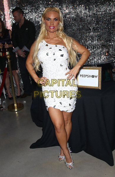 Coco Austin.Coco Austin's Media night in Peep Show  at Planet Hollywood Resort and Casino, Las Vegas, NV., USA..December 17th, 2012.full length white silver one shoulder dress hands on hips.CAP/ADM/MJT.© MJT/AdMedia/Capital Pictures.
