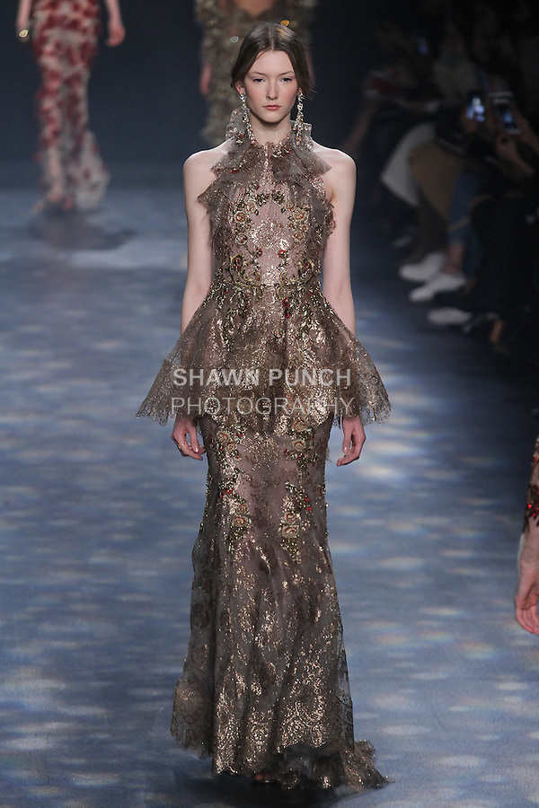 Model Allyson walks runway in a bronze metallic lace fishtail own with halter neck, sculptural peplum and bronze floral embroidery with touches of maroon, from the Marchesa Fall 2016 collection by Georgina Chapman and Keren Craig, presented at NYFW: The Shows Fall 2016, during New York Fashion Week Fall 2016.