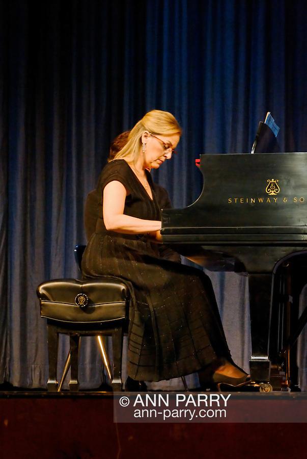 MERRICK - NOV. 13: Marilyn Sherman, pianist, after performing with Stanley Drucker and Naomi Druciker in concert presented by Merrick-Bellmore Community Concert Association, November 13, 2010, in Merrick, NY, USA