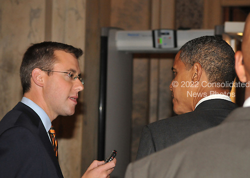 Washington, DC - October 1, 2008 -- United States Senator Barak Obama (Democrat of Illinois) speaks to a reporter as he departs the United States Senate Chamber in the United States Capitol after casting votes on the 700 billion dollar Wall Street bail-out package in Washington, D.C. on Wednesday, October 1, 2008..Credit: Ron Sachs / CNP.(RESTRICTION: NO New York or New Jersey Newspapers or newspapers within a 75 mile radius of New York City)