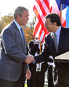 Camp David, MD - October 18, 2008 -- President José Manuel Barroso of the European Commission (EC), right, shakes hands with United States President George W. Bush, left, after making remarks at the Presidential Retreat near Thurmont, Maryland for talks on Saturday, October 18, 2008.  Borroso and Sarkozy stopped at Camp David to meet with President Bush to discuss the economy on their way home from a summit in Canada to try to convince Bush to support a summit by year's end to try to reform the world financial system..Credit: Ron Sachs / Pool via CNP