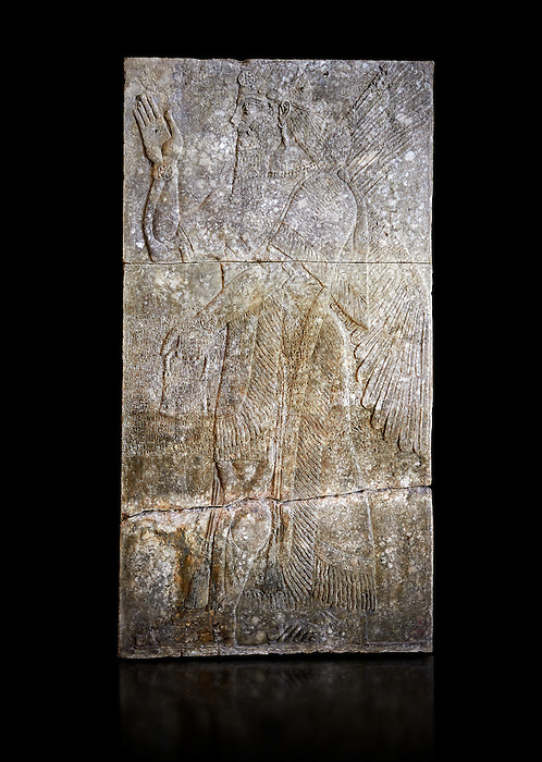 Stone relief sculptured panel of a Genie blessing. From the palace of Assurnasirpal II, Nimrud, circa 865 BC. inv 19847  Louvre Museum , Paris