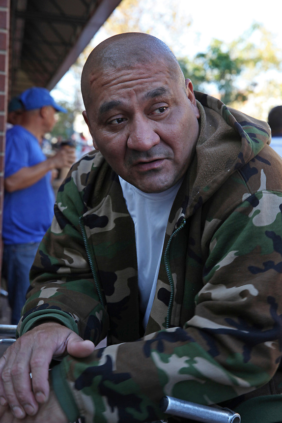 (171015RREI5523) Jose, El Pelon, at La Esquina where Latinos have gathered for decades at the corner of Mt. Pleasant St. and Kenyon St. NW. to play chekers (damas). Washington DC Oct. 15 ,2017 . ©  Rick Reinhard  2017     email   rick@rickreinhard.com