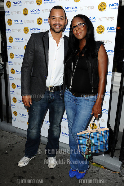 Michael Underwood and Angelica Bell arriving for the Jeans For Genes Launch Party, at Kettners, London. 06/09/2011  Picture by: Steve Vas / Featureflash