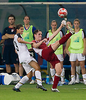 Tobin Heath, Sophie Schmidt. The USWNT defeated Canada in extra time, 2-1, during the 2008 Beijing Olympics in Shanghai, China.