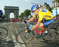 28.07.2002 Passing the Arc De Triomphe US cyclist Lance Armstrong rides along the Champs Elysees during the final rounds of the last stage of the Tour de France in Paris, 28 July 2002. With a lead of 7:17, minutes Armstrong confidently rode towards his fourth Tour De France victory in a row.