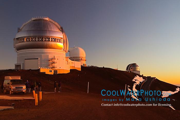 Star-gazing Tourists, Gemini Northern Telescope, University of Hawaii 2.2-meter Telescope, and United Kingdom Infrared Telescope or UKIRT at sunset, Mauna Kea Observatories, Big Island, Hawaii