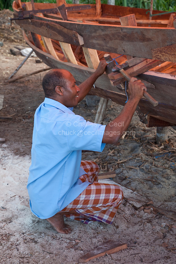 Nungwi, Zanzibar, Tanzania.  Dhow Construction, Boat Building.  Carpenter at Work.