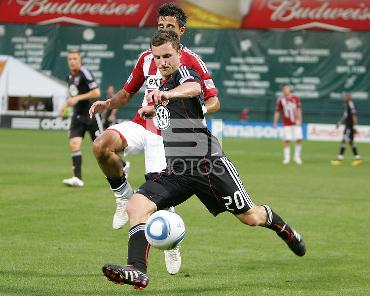 Stephen King #20 of D.C. United moves past Michael Umana #4 of Chivas USA during an MLS match at RFK Stadium, on May 29 2010 in Washington DC. United won 3-2.