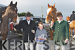 REFRESHMENTS: Young Aaron McCabe (Kilmoyley) given the leaders of the Kingdom Hunt Des Murphy, and Dan O'Leary, from Tochar Bán, Kilmoyley on Sunday.
