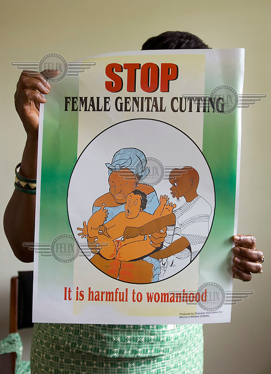 Florence Ali, Director of GAWW (Ghanaian Association for Women's Welfare), holds up a poster condemning FGM (Female Genital Mutilation) which she uses in her campaign to stop the tradition of female circumcision.  Florence visits religious leaders, elders and community chiefs in rural areas in order to try and convince them to abandon the practice..