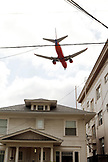 USA, California, San Diego, a plane flies over buildings in Dowtown San Diego
