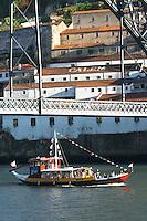 Dom Luis I bridge seen from Cais da Ribeira passenger ferry boat calem port lodge vila nova de gaia porto portugal