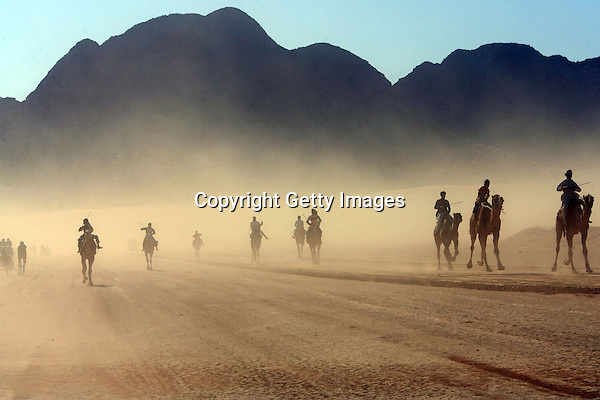 WADI RUM, JORDAN- DECEMBER 14: Beduins youth ride their camels during the annual camel race in the desert of Wadi Rum in the south of Jordan December 14, 2007, where competitors from Saudi Arabia, Egypt and Jordan race for 9km in the traditional beduins' sport. (Photo by Salah Malkawi/ Getty Images)