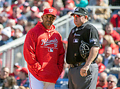 Washington Nationals manager Dave Martinez (4), left, has words with home plate umpire Doug Eddings, right, after Eddings called a questionable strike three on Washington Nationals shortstop Trea Turner (7) and subsequently ejected him from the game in the sixth inning against the New York Mets at Nationals Park in Washington, D.C. on Thursday, April 5, 2018.  The Mets won the game 8-2.<br /> Credit: Ron Sachs / CNP<br /> (RESTRICTION: NO New York or New Jersey Newspapers or newspapers within a 75 mile radius of New York City)