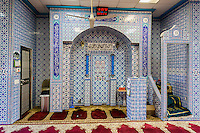 Interior of the Masjid Al-Aman mosque serving the Bangladeshi community in the City Line neighborhood of Brooklyn in New York on Wednesday, November 2, 2016.  The small neighborhood has become an enclave for Bangladeshi immigrants. (© Richard B. Levine)