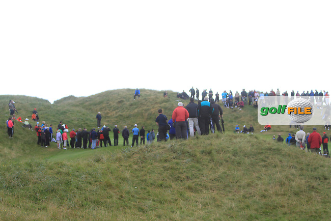 A crowd at the 13th green during the South of Ireland Amateur Open Championship Final at Lahinch Golf Club  31th July 2013 <br /> Picture:  Thos Caffrey / www.golffile.ie