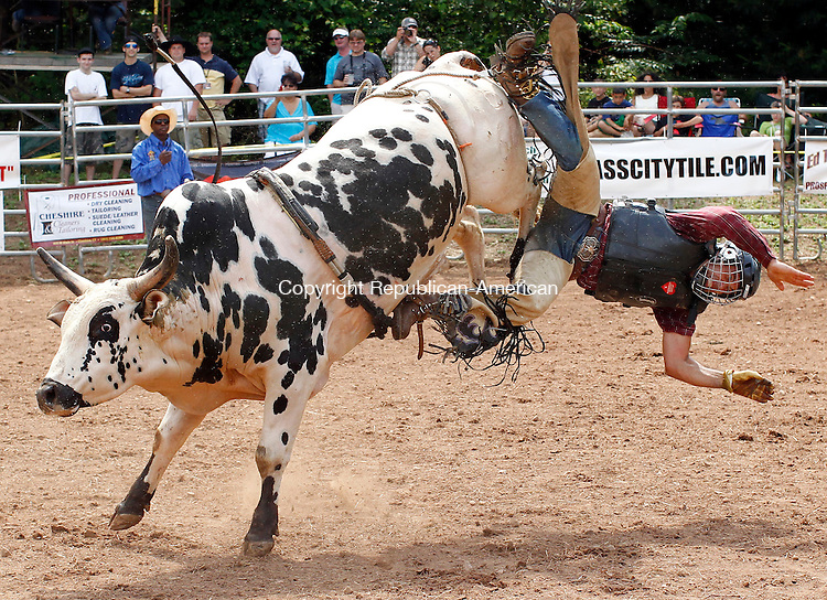 Prospect, CT-05, June 2010-060510CM15 Romdo Compos, of Brazil gets thrown of a bull during the Man Vs. Beast bull riding competition.  The event, held at Senior Poncho's in Prospect, featured top PBR riders from the world circuit.  The event will run again Sunday, from 2-4pm and will feature approximately 32 cowboys.  --Christopher Massa Republican-American