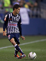 Sergio Pérez of CF Monterrey passes the ball during a CONCACAF Champions League match against the Seattle Sounders FC at CenturyLink Field in Seattle Tuesday Oct. 18, 2011. CF Monterrey won the game 2-1.