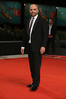 "VENICE, ITALY - SEPTEMBER 05: Roberto Saviano walks the red carpet of the ""ZeroZeroZero"" screening during the 76th Venice Film Festival at Sala Grande on September 05, 2019 in Venice, Italy. (Photo by Mark Cape/Insidefoto)<br /> Venezia 05/09/2019"