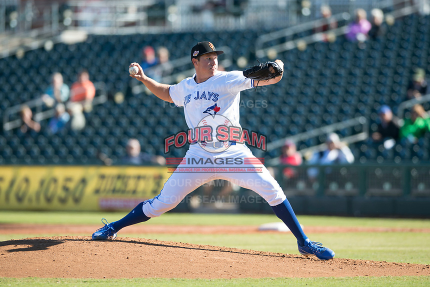 Surprise Saguaros starting pitcher Nate Pearson (20), of the Toronto Blue Jays organization, delivers a pitch during an Arizona Fall League game against the Glendale Desert Dogs at Surprise Stadium on November 13, 2018 in Surprise, Arizona. Surprise defeated Glendale 9-2. (Zachary Lucy/Four Seam Images)
