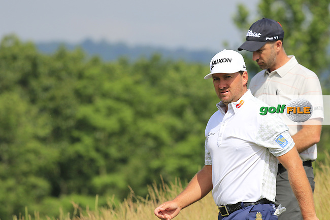 Graeme McDowell (NIR) and Geoff Ogilvy (AUS) walk off the 4th tee during Friday's Round 1 of the 2016 U.S. Open Championship held at Oakmont Country Club, Oakmont, Pittsburgh, Pennsylvania, United States of America. 17th June 2016.<br /> Picture: Eoin Clarke | Golffile<br /> <br /> <br /> All photos usage must carry mandatory copyright credit (&copy; Golffile | Eoin Clarke)