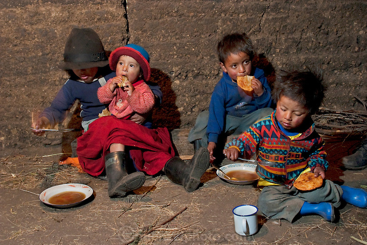 Ermelinda's children enjoy soup and empanadas for breakfast in an earthen hut in the village of Tingo, central Andes, Ecuador. (From the book What I Eat: Around the World in 80 Diets.) The family of eight consists of Ermelinda Ayme Sichigalo, 37, Orlando Ayme, 35, and their children: Livia, 15, Moises, 11, Jessica, 10, Natalie, 8, Alvarito, 4, Mauricio, 30 months, and Orlando hijo (Junior), 9 months. Lucia, 5, lives with her grandparents to help them out.