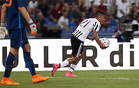 Calcio, Serie A: Roma vs Juventus. Roma, stadio Olimpico, 30 agosto 2015.<br /> Juventus&rsquo; Paulo Dybala handles the ball after scoring during the Italian Serie A football match between Roma and Juventus at Rome's Olympic stadium, 30 August 2015.<br /> UPDATE IMAGES PRESS/Isabella Bonotto