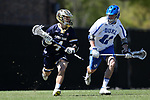 DURHAM, NC - APRIL 08: Notre Dame's Anthony Marini (4) and Duke's Terry Lindsay (11). The Duke University Blue Devils hosted the University of Notre Dame Fighting Irish on April 8, 2017, at Koskinen Stadium in Durham, NC in a Division I College Men's Lacrosse match. Duke won the game 11-8.