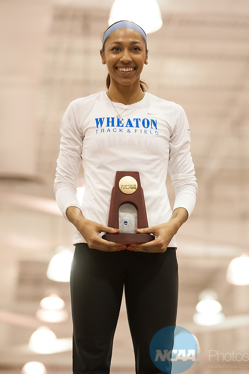 15 March 2014: Ashante Little from Wheaton College celebrates with her championship trophy following her victory in the Women's 400 meter race during the Div III Indoor Track and Field Championships at Devaney Sports Center in Lincoln, Nebraska.