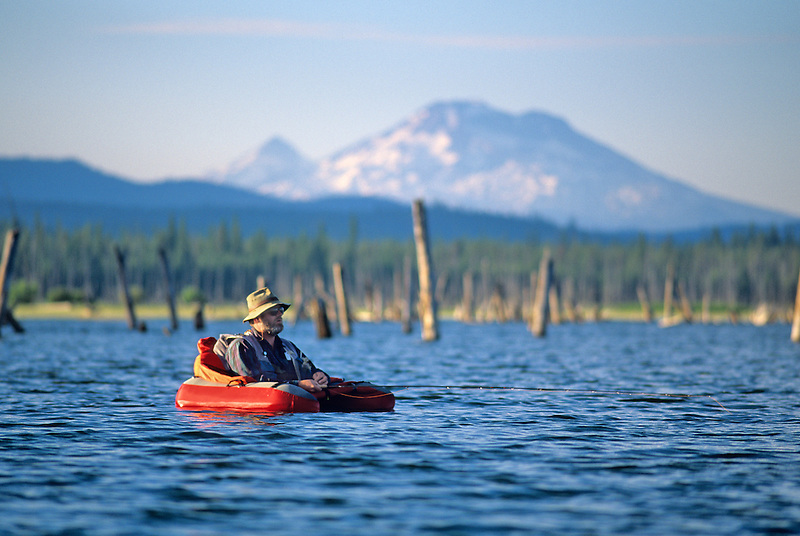 Fly fisherman in float tube. Crane Prairie, Oregon.