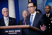 Secretary of Treasury Steve Mnuchin, with members of the coronavirus taskforce, responds to a question from the news media during a COVID-19 coronavirus press conference at the White House in Washington, DC, USA, 14 March 2020. To date there are 2175 confirmed cases of COVID-19 coronavirus in the US with 50 deaths.<br /> Credit: Shawn Thew / Pool via CNP/AdMedia