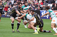 Sunday 19 October 2014<br /> Pictured: Ospreys defenders Full-back Dan Evans and prop Scott Baldwin tackle Treviso wing Ludovico Nitoglia.<br /> Re: Ospreys v Treviso, Heineken Champions Cup at the Liberty Stadium, Swansea