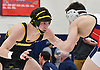 Brian Kelly of St. Anthony's, left, battles Joseph Lanciotti of St. John the Baptist at 138 pounds during the NSCHSAA varsity wrestling championships at St. John the Baptist High School on Sunday, Feb. 5, 2017. Kelly won the tightly-contested match by decision 4-3.