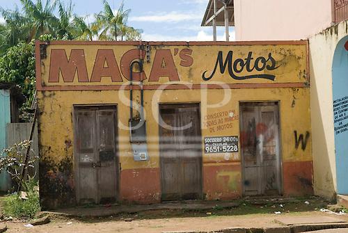 Altamira, Brazil. Maca's Motos, a dilapidated closed down motorcycle repair shop.