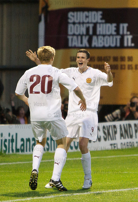 Jonathan Page (L) celebrates with goal provider Jamie Murphy