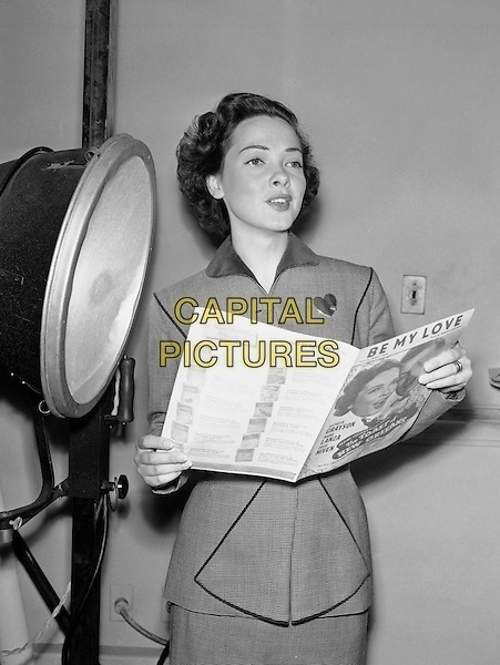 Kathryn Grayson, This Sept. 3, 1950 file photo shows Kathryn Grayson, motion picture soprano, rehearsing a song she will sing on the radio in New York.*Filmstill - Editorial Use Only*.CAP/PLF.Supplied by Capital Pictures.