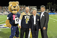 25 October 2011:  At the end of the first quarter, FIU President Mark Rosenberg, Athletic Director Pete Garcia and mascot Roary honored a donor who has pledged a $1 million donation to FIU.  The FIU Golden Panthers defeated the Troy University Trojans, 23-20 in overtime, at FIU Stadium in Miami, Florida.