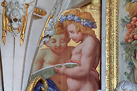 Putti from the frame of the fresco of a Fontainebleau nymph, 1860, by Jean Alaux, called Le Romain, 1786-1864, after an engraving by Rene Boyvin, 1525-80, in the Galerie Francois I, begun 1528, the first great gallery in France and the origination of the Renaissance style in France, Chateau de Fontainebleau, France. The Palace of Fontainebleau is one of the largest French royal palaces and was begun in the early 16th century for Francois I. It was listed as a UNESCO World Heritage Site in 1981. Picture by Manuel Cohen